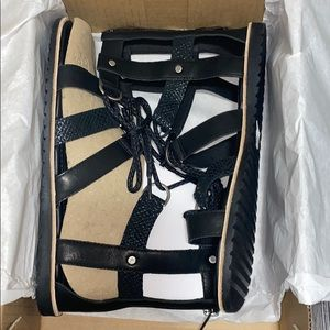 Brand new lace up Sorel sandals